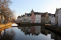 BRUGES, BELGIUM - FEBRUARY 06 : A panoramic view of a cross of canals at sunset on February 06, 2009 in Bruges, West Flanders, Belgium. The pink facade of the typical stepped gable roof house in the middle of the view balances the constrasting light of sunset with shadows. (Photo by Manuel Cohen)