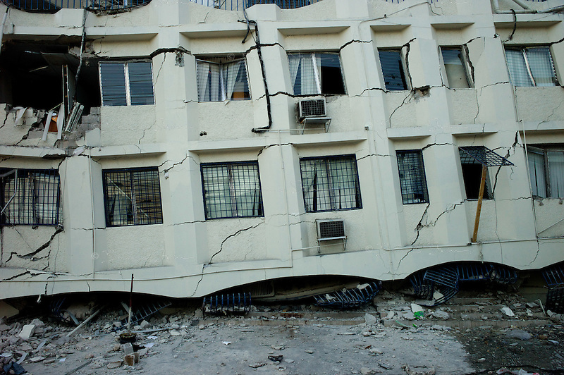 Port Au Prince, Haiti, Jan 22 2010.One of many collapsed buildings in the city, menacing to fall at every moment..