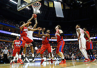 Ohio State Buckeyes forward LaQuinton Ross (10) leaps for a rebound in the first half of the second-round NCAA Tournament game between the Ohio State Buckeyes and the Dayton Flyers at the First Niagara Center, Thursday afternoon, March 20, 2014. The Dayton Flyers defeated the Ohio State Buckeyes 60 - 59. (The Columbus Dispatch / Eamon Queeney)