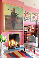 The colourful 'den' has an Indian theme and the fireplace wall is dominated by a portrait of an Indian fusilier