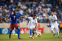 Honduras forward Roger Rojas (21) is marked by Haiti defender Judelin Aveska (8). Honduras defeated Haiti 2-0 during a CONCACAF Gold Cup group B match at Red Bull Arena in Harrison, NJ, on July 8, 2013.