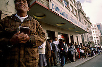 Forming a line around the block,  Paceños wait outside two movie theaters in the central banking district of La Paz for evangelical church services. Many of the larger denominations fill former movie theaters with hundreds of worshipers each Sunday morning.