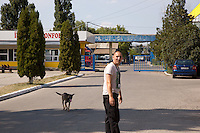 Romania. Iași County. Iași. A security guard on duty and his dog at the entrance of the Tehnoton factory which is is a Romanian company founded in 1972 in Iaşi, mainly manufacturing home electronics and industrial machinery. Above the entrance, a slogan dating from the communist time celebrates the Socialist Republic of Romania. The Socialist Republic of Romania (Romanian: Republica Socialistă România, RSR) was a single-party socialist state that existed officially from 1947 to 1989. The country was a Soviet-aligned Eastern Bloc state with a dominant role for the Romanian Communist Party enshrined in its constitutions. Iași (also referred to as Iasi, Jassy or Iassy) is the largest city in eastern Romania and the seat of Iași County. Located in the Moldavia region, Iași has traditionally been one of the leading centres of Romanian social life. The city was the capital of the Principality of Moldavia from 1564 to 1859, then of the United Principalities from 1859 to 1862, and the capital of Romania from 1916 to 1918. 7.06.15© 2015 Didier Ruef