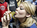Fathoms O' Fun Queen Bailey Nelson kisses the Nathan Hegarty's winning frog that took first place with a jump of over nine feet. Jim Bryant Photo