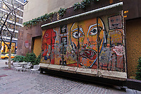 Paley Park, The Berlin Wall, by German artists Thierry Noir and Kiddy Citny, E 53rd St, 520 Madison Avenue Courtyard, Manhattan, New York City, New York, USA