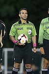 08 October 2013: Referee Hilario Grajeda. The University of North Carolina Tar Heels hosted the Clemson University Tigers at Fetzer Field in Chapel Hill, NC in a 2013 NCAA Division I Men's Soccer match. Clemson won the game 2-1 in overtime.