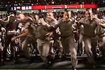 Corps of Cadets freshmen run onto Kyle Field at the close of a football game in 2007 to chase the Aggie Yell Leaders.<br /> <br /> The freshmen, known as &quot;fish,&quot; chase the Yell Leaders after home victories and carry them to &quot;Fish Pond,&quot; a fountain on the A&amp;M campus, to be dunked.
