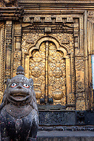 Nepal, Changu Narayan Temple, Western Entrance, before April 2015 earthquake.  The temple was heavily damaged in the earthquake, but will be repaired.  This shows one door of the torana, the elaborate brass gateway to the temple.  Lotus design on the door panel.