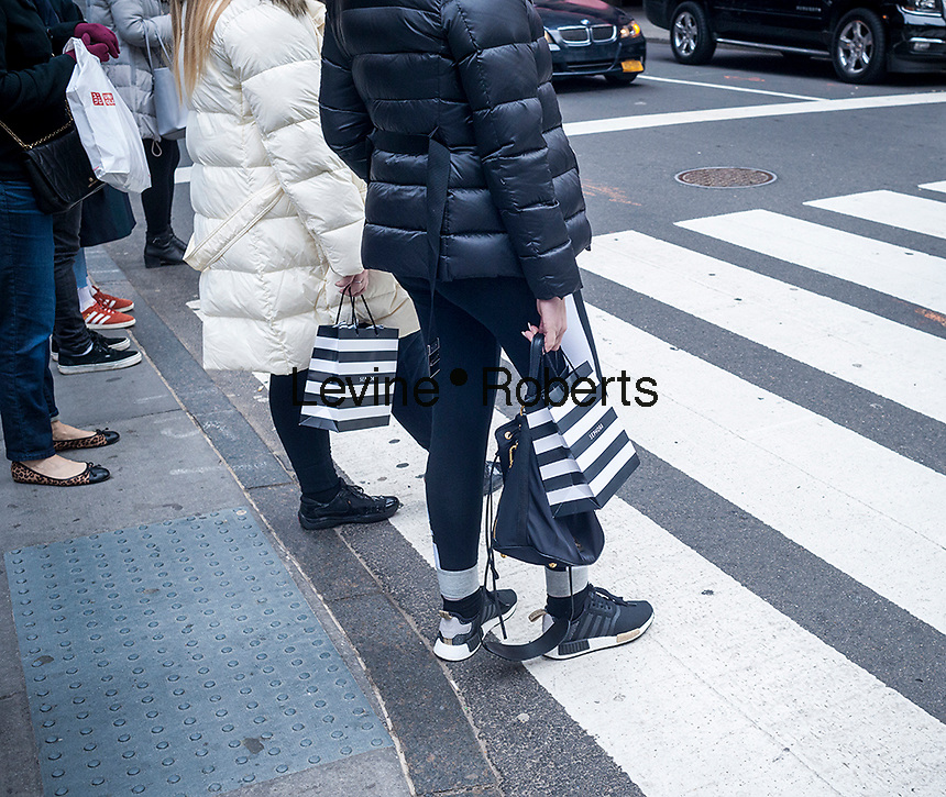 Shoppers in New York with Sephora shopping bags on Tuesday, February 28, 2017. Consumer confidence is reported to be at the highest level since July 2001.(© Richard B. Levine)