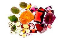 GARNET<br /> Garnet Color Varieties<br /> From left to right: green garnet - grossularite, Orange garnet - spessarite, deep red garnet- pyrope, red-pink garnet- rhodolite.