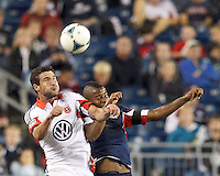 D.C. United midfielder Chris Pontius (13) and New England Revolution defender Andrew Farrell (2) battle for head ball.  In a Major League Soccer (MLS) match, the New England Revolution (blue) defeated D.C. United (white), 2-1, at Gillette Stadium on September 21, 2013.