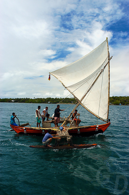 """Traditional Yapese Boat near the  small Island of Yap know for its Stone Money located in the South Pacific and is part of Micronesia. Time has stood still in this part of the world and the Yapese treasure even today their culture and tradition. Women walking around topless without a shame and go about their daily life. But Yap is also famous for its """"resident"""" large Manta Rays and many other amazing ddive sites. Yap, Micronesia"""