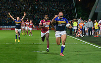 Picture by Allan McKenzie/SWpix.com - 25/09/2015 - Rugby League - First Utility Super League - Huddersfield Giants v Leeds Rhinos - John Smith's Stadium, Huddersfield, England - Leeds's Ryan Hall celebrates as he outpaces Huddersfield's Jermaine McGillvary to score the winning try.
