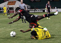 WASHINGTON, DC - AUGUST 4, 2012:  Brandon McDonald (4) of DC United trips over Jairo Arrieta (25) of the Columbus Crew during an MLS match at RFK Stadium in Washington DC on August 4. United won 1-0.