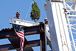 08/17/2011- Medford, Mass. - Construction workers raise the final beam of the superstructure at the topping off ceremony for the Steve Tisch Sports and Fitness Center on Aug. 17, 2011.  (Kelvin Ma/Tufts University)