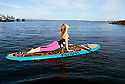 PE00286-00...WASHINGTON - Carly Hayden doing paddle board yoga in the Puget Soundat at Brackett's Landing North, Edmonds.  (MR #H13)