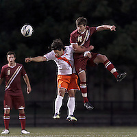 Syracuse University midfielder Alex Halis (7) and Boston College midfielder/defender Dylan Pritchard (14) battle for head ball. Boston College (maroon) defeated Syracuse University (white/orange), 3-2, at Newton Campus Field, on October 8, 2013.