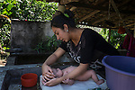 November 10, 2014. &quot;Water it&acute;s the real thing&quot;<br /> Corina with her daughter Susan in her house of Nejapa (El Salvador).<br />  The people of Nejapa have no drinking water because the Coca -Cola company overexploited the aquifer in the area, the most important source of water in this Central American country. This means that the population has to walk for hours to get water from wells and rivers. The problem is that these rivers and wells are contaminated by discharges that makes Coca- Cola and other factories that are installed in the area. The problem can increase: Coca Cola company has expansion plans, something that communities and NGOs want to stop. To make a liter of Coca Cola are needed 2,4 liters of water. &copy;Calamar2/ Pedro ARMESTRE