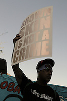 """Phoenix, Arizona. June 25, 2012 - A demonstrator holds a sign that reads """"Brown is not a Crime"""" at the protest against the U.S. Supreme Court ruling on SB 1070. Arizona's own immigration policies have resulted in documented cases of racial profile against brown-skinned people. Immigrant rights groups protested the United States Supreme Court ruling on Arizona law for upholding SB 1070's provision that will allow police to demand papers if there's reasonable suspicion that a person may be illegally in the country. Photo by Eduardo Barraza © 2012"""