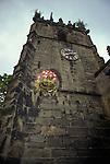 Castleton Garland Day Castleton Derbyshire UK May 29th.  Garland of flowers being hoisted up the church tower.