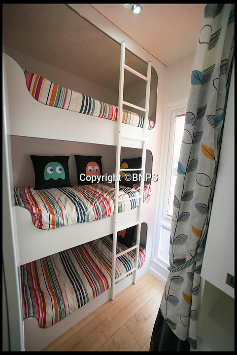 BNPS.co.uk (01202 558833)<br /> Pic: LauraDale/BNPS<br /> <br /> The caravan's triple bunk beds - a permanent feature.