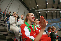(Center) Inna Zhukova of Belarus cheers for Belarus senior group on the carpet  at 2007 Portimao World Cup of Rhythmic Gymnastics on April 28, 2007 at Portimao, Portugal.  (Photo by Tom Theobald).