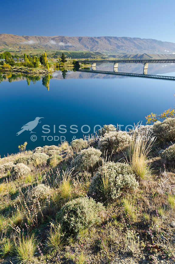 A tranquil morning at Cromwell with reflections of the bridge over Lake Dunstan, Central Otago, South Island, New Zealand. Early Autumn.