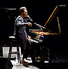Benjamin Clementine<br /> performing live at The Barbican Centre, London, Great Britain <br /> 1st April 2015 <br /> <br /> Benjamin Clementine<br /> <br /> <br /> Photograph by Elliott Franks<br /> <br /> Benjamin Sainte-Clementine is an English musician, poet and pianist. He grew up in North London before moving to France and subsequently performed on the British television programme Later With Jools Holland. He has been particularly praised for his unique piano playing, charisma on stage and his powerful vocals which is mostly compared to that of Nina Simone and Antony Hegarty. He is noticeably seen playing on stage entirely in black or dark grey long trench-like woollen coat with no shirt underneath, in bare feet.