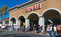 Occupy Orange County protesters march through a shopping center in front of a Rite Aid near the intersection of Alton and Culver in Irvine CA.  The protesters were heading towards a Bank of America in the shopping center, and were not protesting at the Rite Aid.