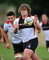 Nick Auterac of Bath Rugby receives the ball. Bath Rugby training session on September 4, 2015 at Farleigh House in Bath, England. Photo by: Patrick Khachfe / Onside Images