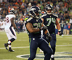 Seattle Seahawks running back Thomas Rawls celebrates in the end zone after scoring a touchdown against the Denver Broncos during the fourth quarter at CenturyLink Field on August 14, 2015 in Seattle Washington.  Rawls run for a touchdown on a 19-yard pass from quarterback A.J. Archer. The Broncos beat the Seahawks 22-20.  © 2015. Jim Bryant Photo. All Rights Reserved.