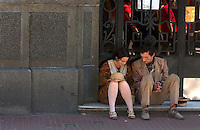 Street performers dressed as early 20th-century immigrants rest on the Plaza Dorrego in Buenos Aires. Noted Argentine author Jorge Luis Borges wrote often about people on the margins -- thugs, knife fighters, prostitutes and scoundrels. The magic realist author influenced the work of many of the western hemisphere's greatest writers.<br />