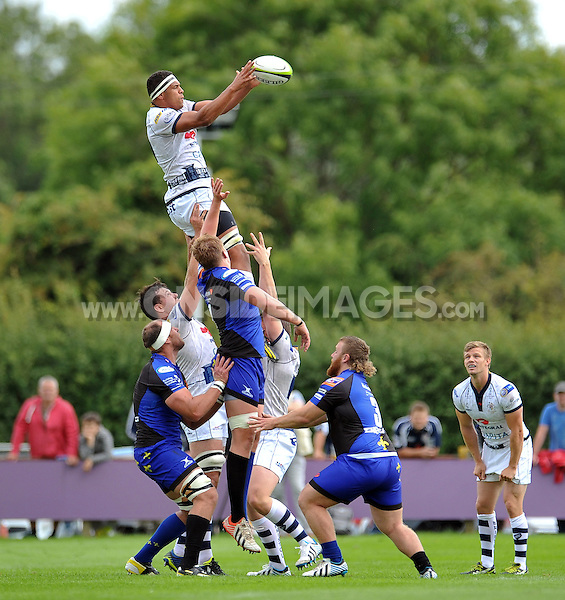 Ben Glynn rises high to win lineout ball. Pre-season friendly match, between Bristol Rugby and Newport Gwent Dragons on August 17, 2014 at the Cribbs Causeway Ground in Bristol, England. Photo by: Patrick Khachfe / JMP