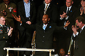 Washington, D.C. - January 23, 2007 -- Wesley Autrey, the 50 year-old construction worker who won the Bronze Medallion for saving a man who had fallen in a New York City subway station, acknowledges the applause as he is introduced during United States President George W. Bush delivers his State of the Union Address to a joint session of the United States Congress at the Capitol in Washington, D.C. on January 23, 2007. .Credit: Ron Sachs / CNP