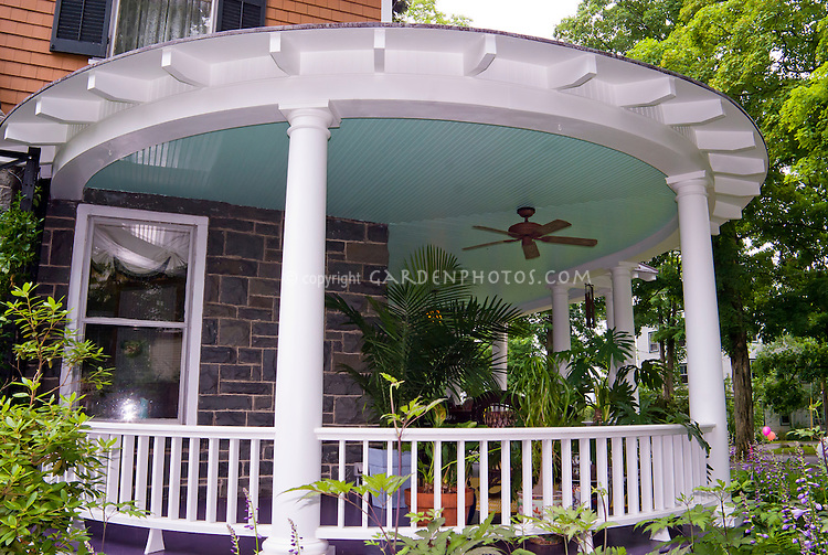 Lovely round porch, hostas, tropcial plants in containers, fan