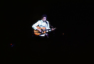 Chicago Stadium, Chicago IL - January 3, 1974. This photograph was taken of Bob Dylan playing at the first show of his bands 1974 tour, after an 8-year absence. Bob Dylan (born May 24, 1941) is an American musician, singer-songwriter, artist and writer, who has also been an influential figure in pop music and culture for over 5 decades.