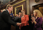 United States Representative Gabrielle Giffords (Democrat of Arizona) (C) is greeted by U.S. Representative Jeff Flake (Republican of Arizona) and DNC Chairwoman Debbie Wasserman-Schultz (Democrat of Florida) before U.S. President Barack Obama's State of the Union address in front of a joint session of Congress on Tuesday, January 24, 2012 on Capitol Hill in Washington, DC. .Credit: Saul Loeb / Pool via CNP