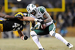 PITTSBURGH, PA - JANUARY 23: Braylon Edwards #17 of the New York Jets is tackled by Troy Polamalu #43 of the Pittsburgh Steelers in the AFC Championship Playoff Game at Heinz Field on January 23, 2011 in Pittsburgh, Pennsylvania(Photo by: Rob Tringali) *** Local Caption *** Braylon Edwards;Troy Polamalu