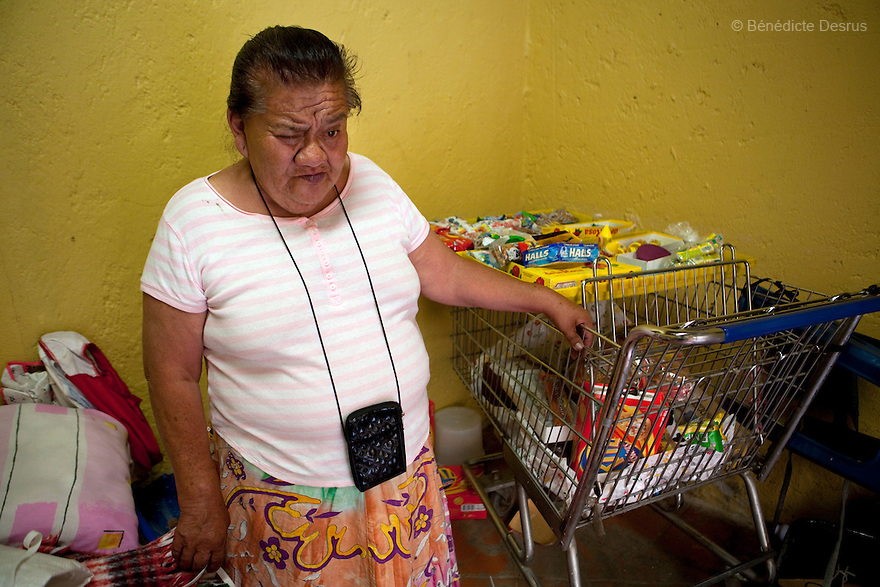 Canela, a resident of Casa Xochiquetzal, in her bedroom at the shelter in Mexico City, Mexico on April 12, 2012. Casa Xochiquetzal is a shelter for elderly sex workers in Mexico City. It gives the women refuge, food, health services, a space to learn about their human rights and courses to help them rediscover their self-confidence and deal with traumatic aspects of their lives. Casa Xochiquetzal provides a space to age with dignity for a group of vulnerable women who are often invisible to society at large. It is the only such shelter existing in Latin America. Photo by Bénédicte Desrus