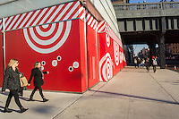 "People walk past the Target ""Wonderland"" pop-up store prior to its opening in the trendy Meatpacking District in New York on Saturday, December 5, 2015. Target recently announced plans to open a second permanent store in Manhattan in the Tribeca neighborhood. (© Richard B. Levine)"