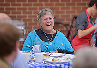 STAFF PHOTO BEN GOFF  @NWABenGoff -- 09/28/14 Lesli Misenheimer laughs with her tablemates during a meal at First United Methodist Church served by volunteers with Samaritan Community Center as a way for church members to learn about the center and it's work on Sunday September 28, 2014. The meal is part of a series of events examining the hunger problem in Northwest Arkansas.