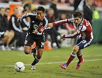 D.C. United defender Andy Najar (14) goes against Chivas USA defender Jorge Villafana (19) D.C. United defeated Chivas USA 1-0 at RFK Stadium, Sunday September 23, 2012.