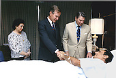Washington, D.C. - July 5, 1988 -- United States President Ronald Reagan and Vice President George H.W. Bush visit President Jose Napoleon Duarte of El Salvador at Walter Reed Hospital in Washington, DC on July 5, 1988.  Mrs. Duarte, left, was also on hand for the bedside visit..Credit: White House via CNP