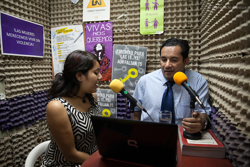 "Sara García Gross (L) and Dennis Estanley Muñoz Rosa (R), a lawyer working with rights groups to free women in prison on abortion charges, talk during a radio program called ""From the hospital to the prison"" at ""La Casa de Todas"" in San Salvador, El Salvador on June 10, 2015. Abortion in El Salvador is illegal. The law formerly permitted an abortion to be performed under some limited circumstances, but, in 1998, all exceptions were removed when a new abortion law went into effect. Photo by Bénédicte Desrus"