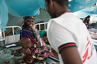 An MSF clinical officer giving Plumpy Nut, a high calorie therapeutic food to a malnourished child in Dadaab refugee camp in northern Kenya.