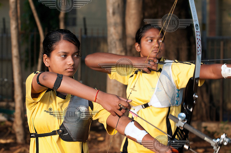 Girls practise at the Archery Academy. Talented young boys and girls from all levels of society are selected at annual try outs and given the chance to enroll at the Archery Academy. Tata provides education and training. The best compete in national and international competitions.