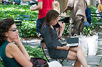 A reader uses her Amazon Kindle electronic book in Bryant Park in New York on Tuesday, July 24, 2012 (© Richard B. Levine)