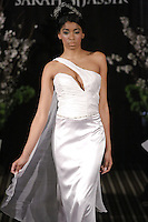 Model walks runway in a Swoon wedding dress by Sarah Jassir, for the Sarah Jassir Fall 2011 - Desire bridal collection.