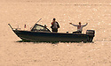 How big was the fish? Fishermen in boat at Lex's Landing on the Rogue River; Gold Beach, southern Oregon coast.