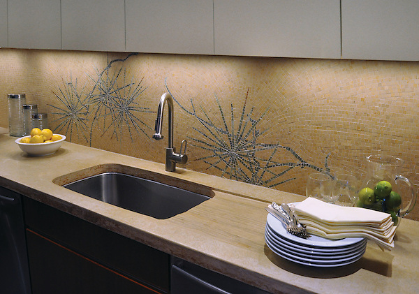 Ikebana, a natural stone hand cut mosaic shown in Lagos Gold (h), Verde Luna, Travertine Noce and Topaz Onyx (p), is by James Duncan for New Ravenna Mosaics.